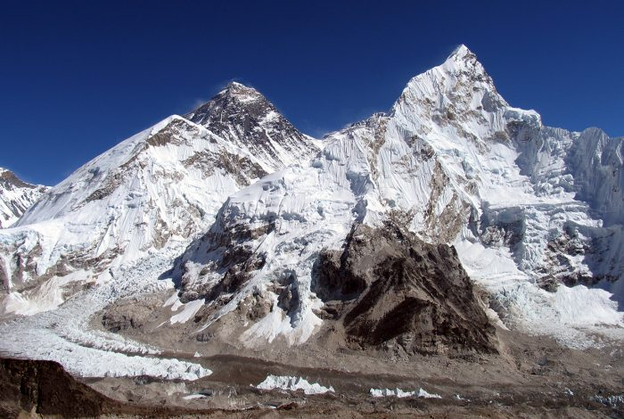 Mount Everest, the highest in the world, 8850m. The peak is always black because the wind blows away the snow. To the right Mount Lhotse, the 4th highest with 8516m. The glacier is the entry way for the climbing expeditions to Everest.